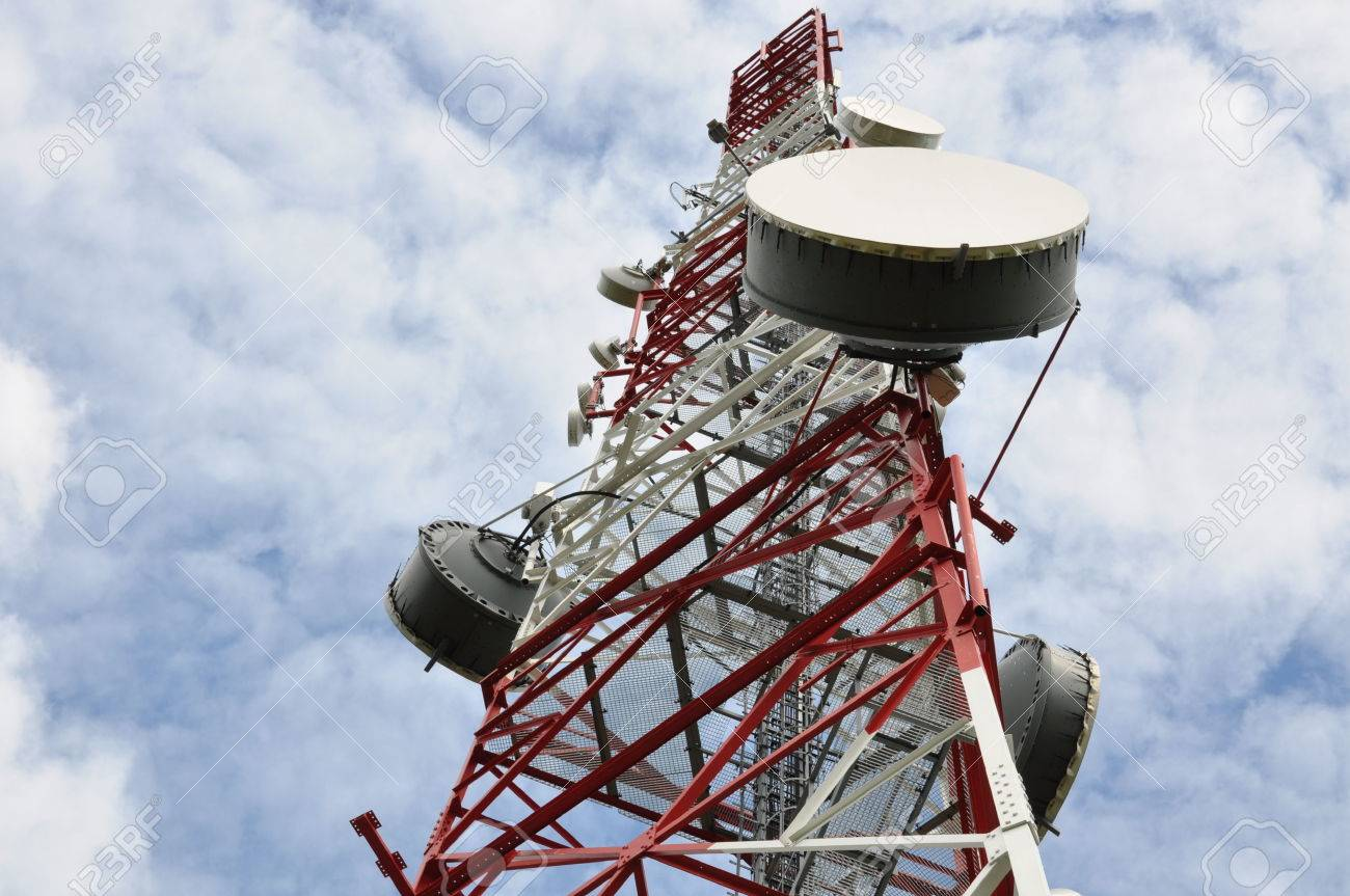 telecommunication tower with microwave link against a blue sky