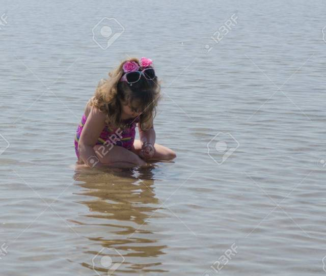Girl Playing By Herself At Beach Stock Photo 13864159