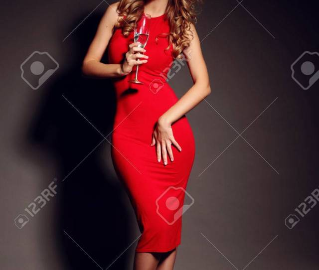 Party Photo Of Sexy Lady In Red Dress With Red Lips And Blond Beautiful Curly Hair