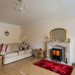 Living Room With Log Burner Black Brown Furniture Modern In Fireplace As Central Focus Stock Photo
