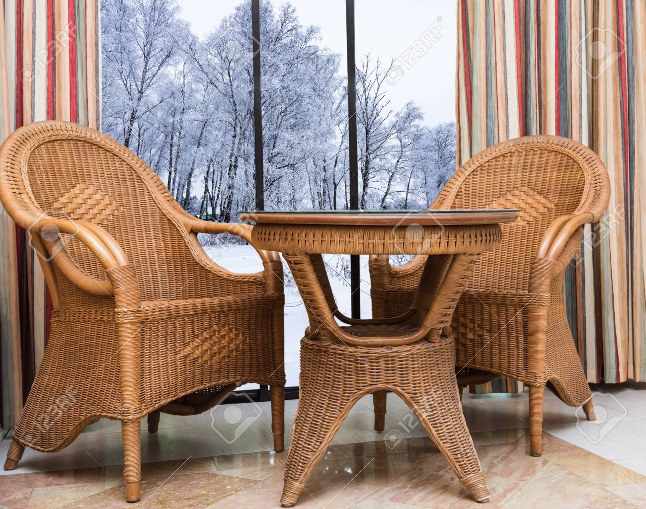 Table With Two Chairs Wicker Furniture Rattan Table Two Chairs Near The Window With
