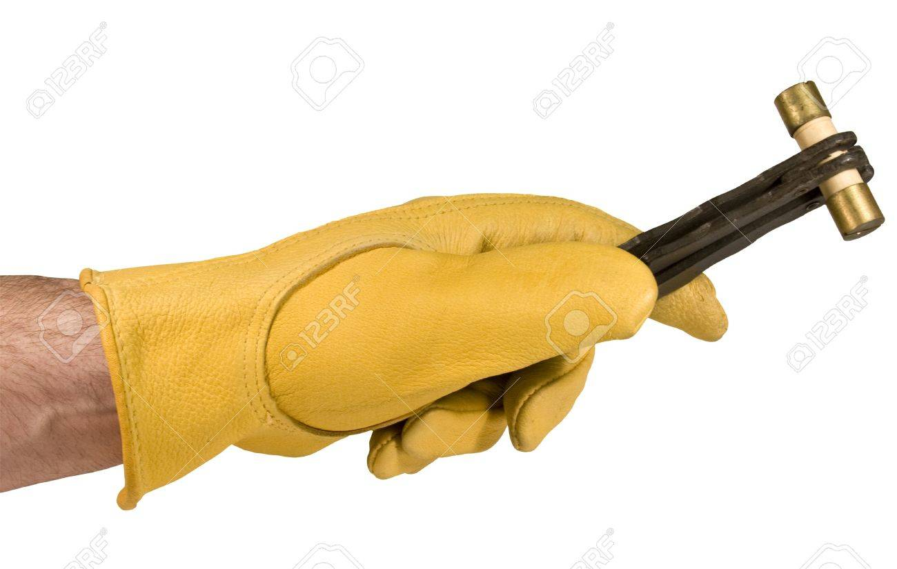 hight resolution of electrician with gloved hand holding a fuse in a fuse puller isolated over a white background