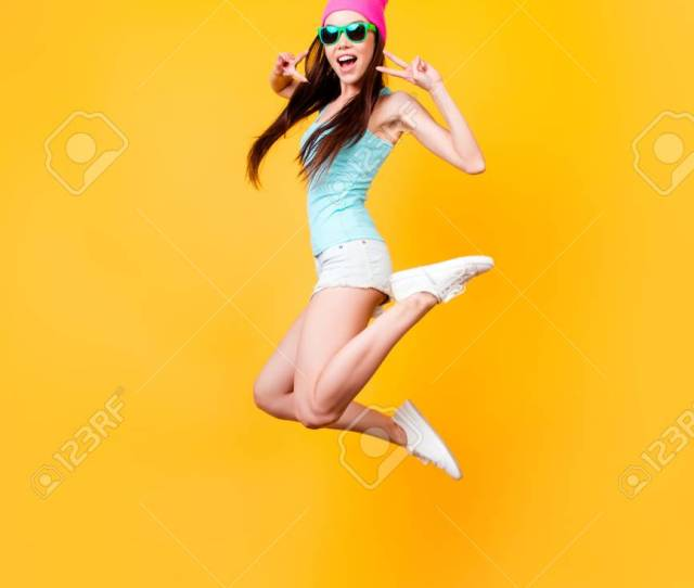 Happiness Dream Fun Joy Concept Very Excited Happy Cute Asian Teen Is Jumping Up Wearing Casual Summer Clothes White Shoes On Bright Yellow