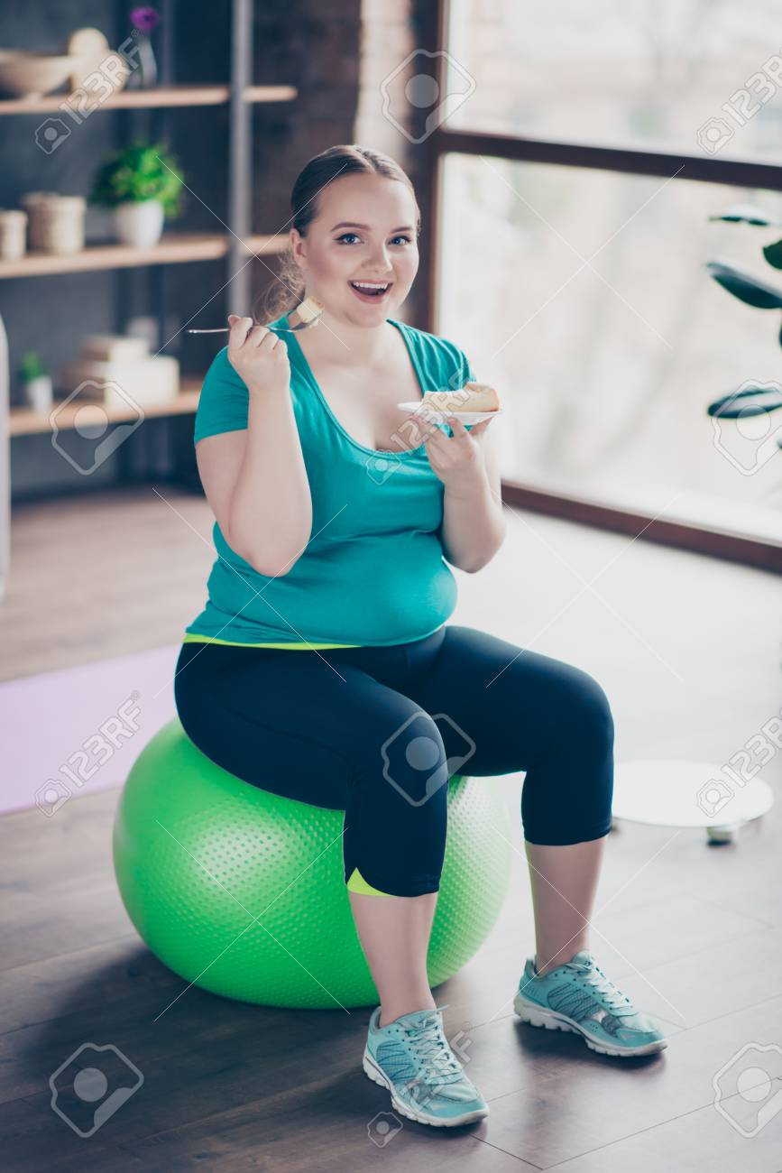 Funny Chubby Plus Size Excited Cheerful Woman Is Holding A Plate With Tasty Dessert And