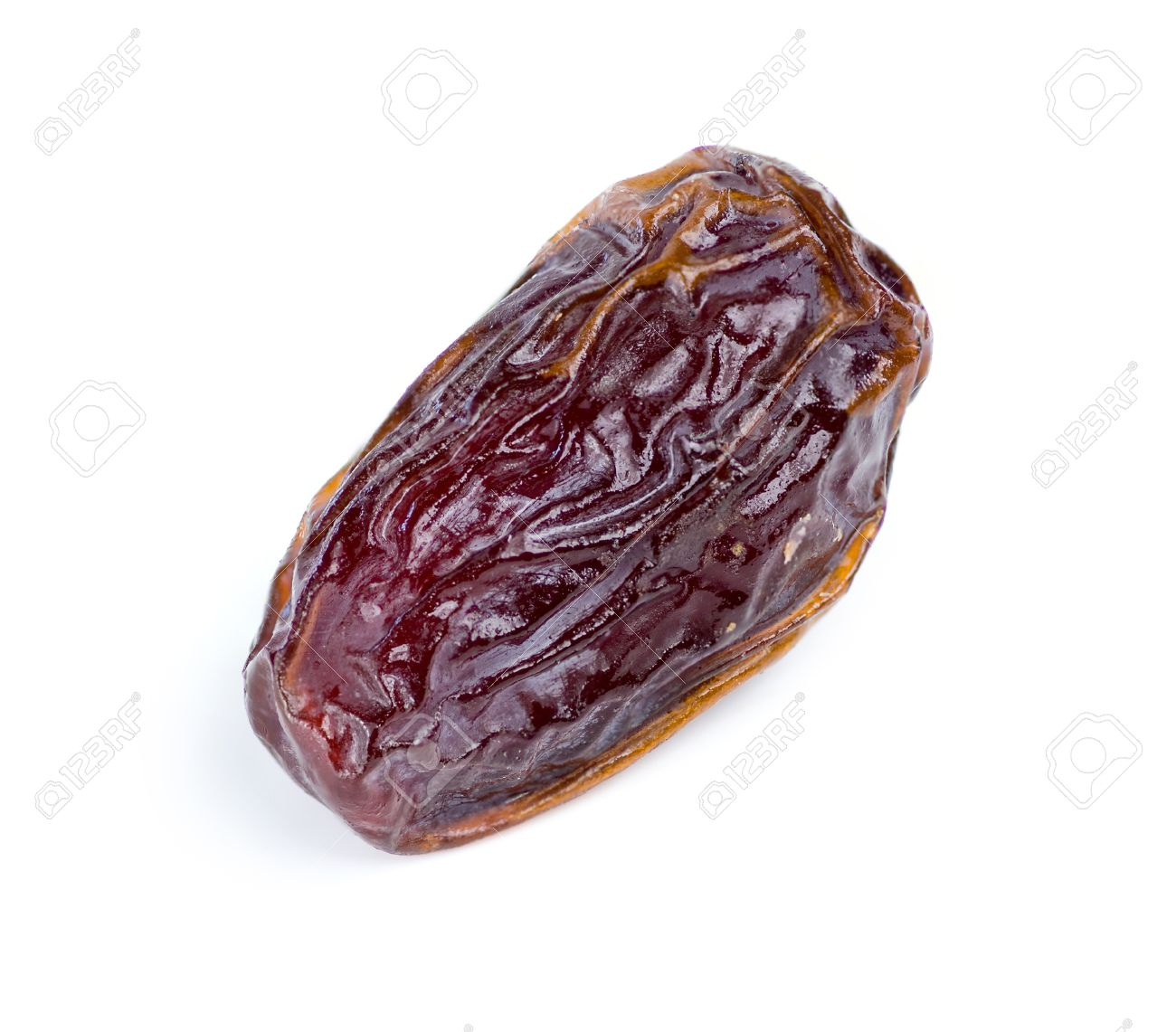 Closeup Of Date Fruit Against White Stock Photo Picture And