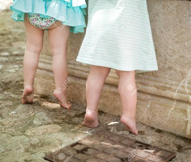 Small Barefoot Girls Near The Fountain In Alfabia Gardens In Mallorca Spain Stock Photo