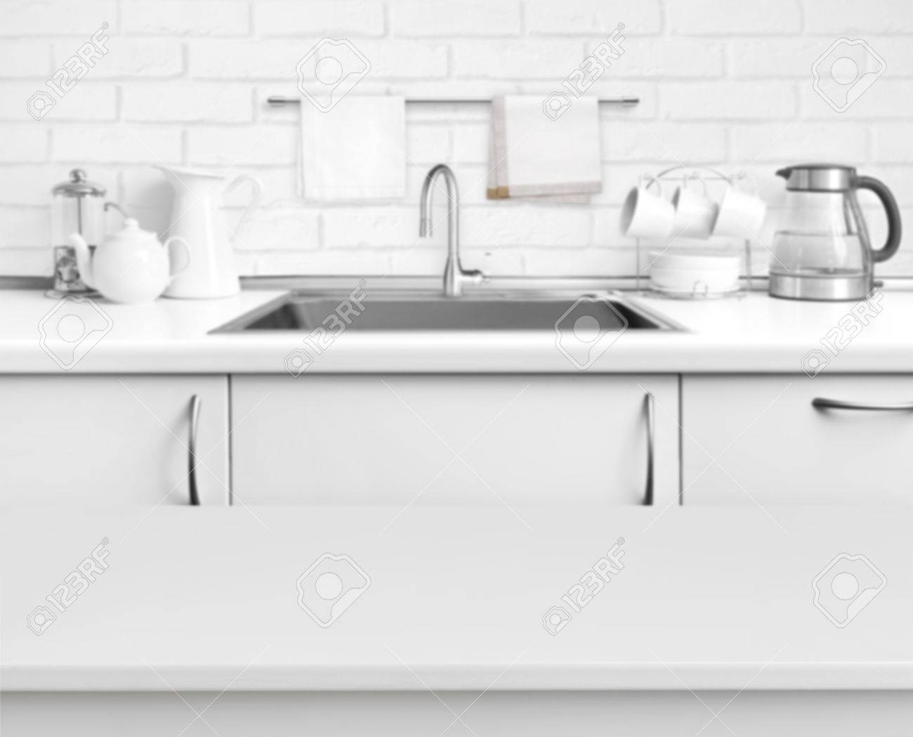 rustic kitchen sink swags and valances white laminated table on blurred interior stock photo background