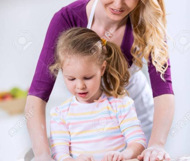 Mom Teaches Daughter How To Use A Rolling Pin Stock Photo 58606479