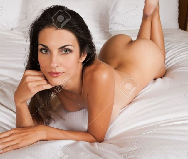 Beautiful Slender Brunette Lying Nude In Bed Stock Photo 11051338