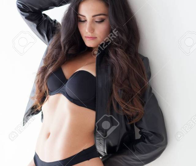 Brunette Girl In Leather Jacket And Black Lingerie Stock Photo 82872821