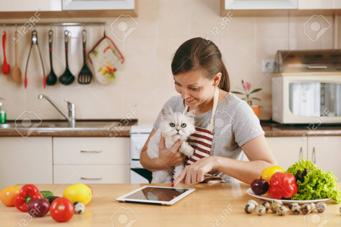 cats in the kitchen cabinets to go young pretty woman with white persian cat stock photo tablet on table vegetable salad dieting concept healthy lifestyle