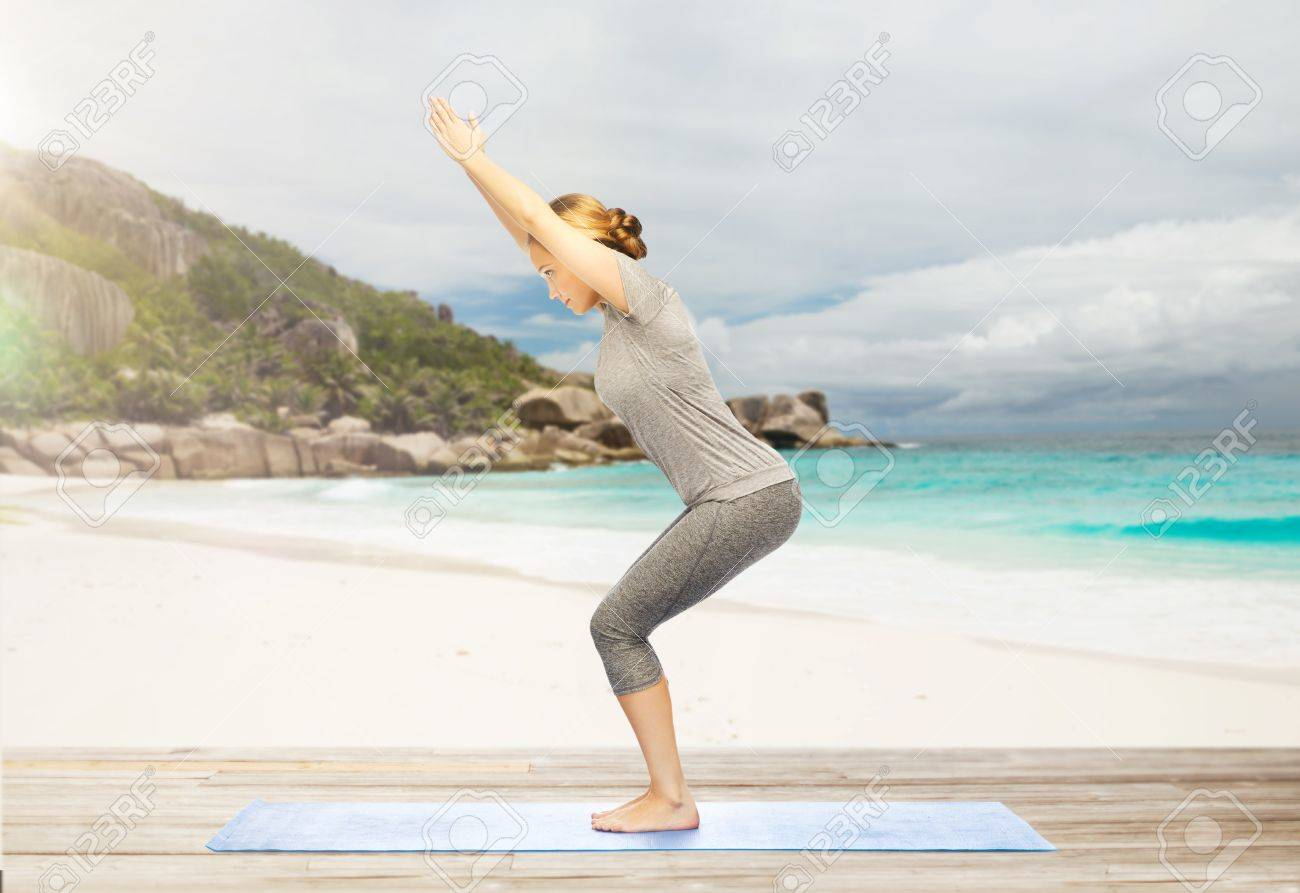 yoga chair pose outdoor covers big w woman doing on beach stock photo picture and