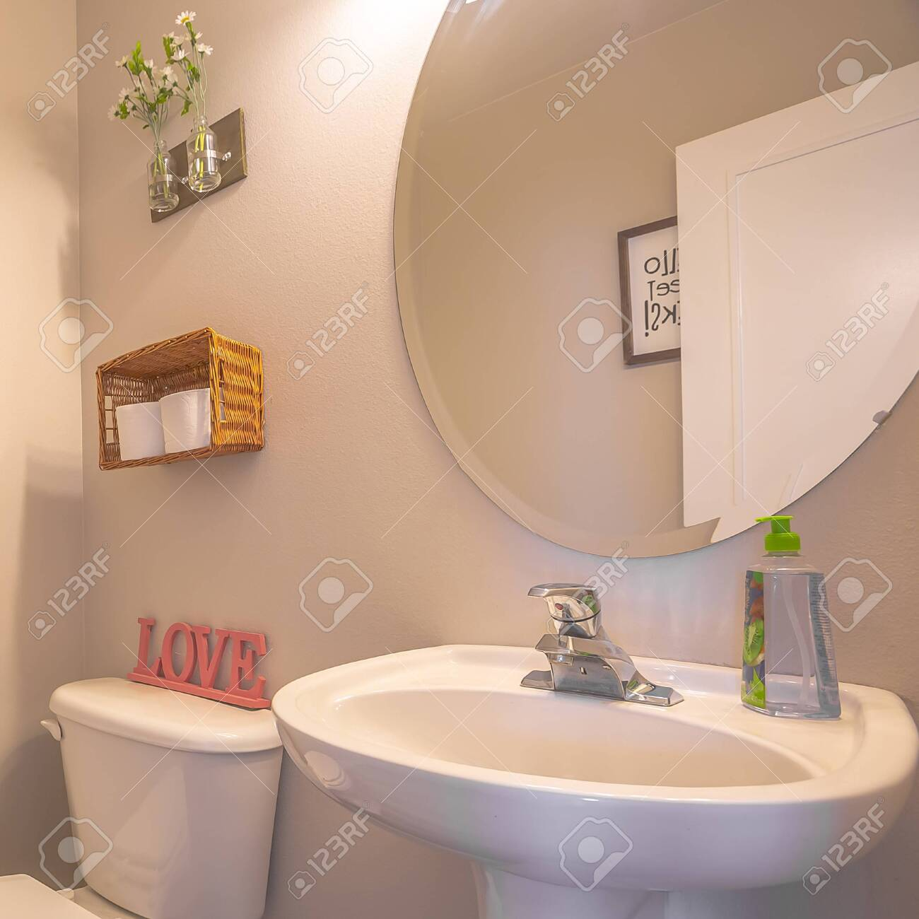 https www 123rf com photo 137183285 square bathroom interior with toliet adjacent to stand alone sink and round mirror clean bathroom of html
