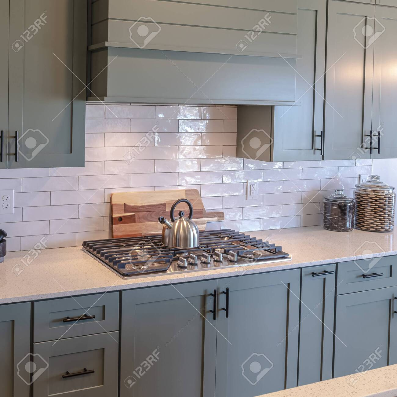 https www 123rf com photo 139157173 photo square frame wooden cabinets and white counter top inside a kitchen with tile backsplash kitch html