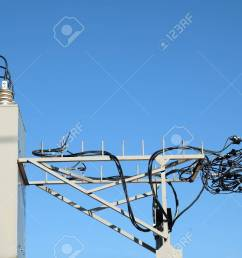stock photo top part of rural power supply transformer with high voltage wires [ 1300 x 866 Pixel ]