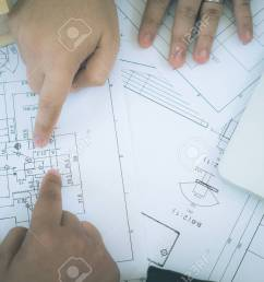 architect or planner working on drawings for construction plans at a table stock photo 83802518 [ 1300 x 866 Pixel ]