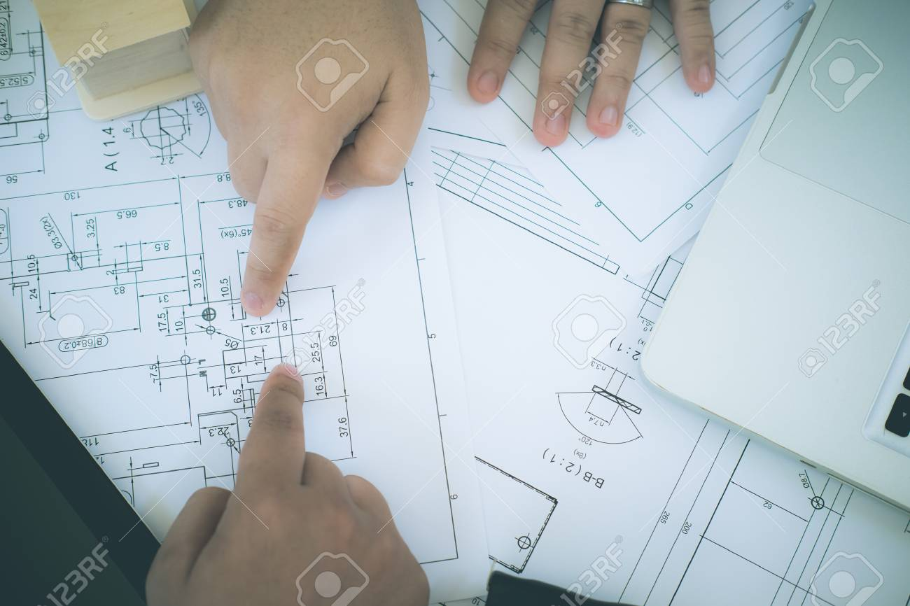 hight resolution of architect or planner working on drawings for construction plans at a table stock photo 83802518