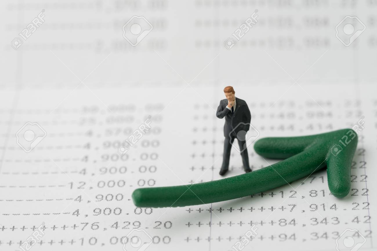 Miniature Business Man Standing And Thinking With Green Arrow Stock Photo Picture And Royalty Free Image Image 97517713
