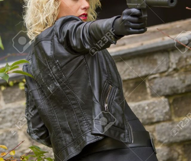 Sexy Secret Female Agent Aiming With A Silencer Gun Stock Photo