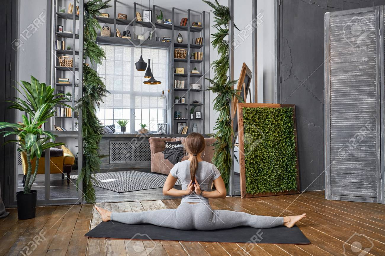 Woman Practicing Advanced Yoga In The Living Room At Home A Stock Photo Picture And Royalty Free Image Image 80228185