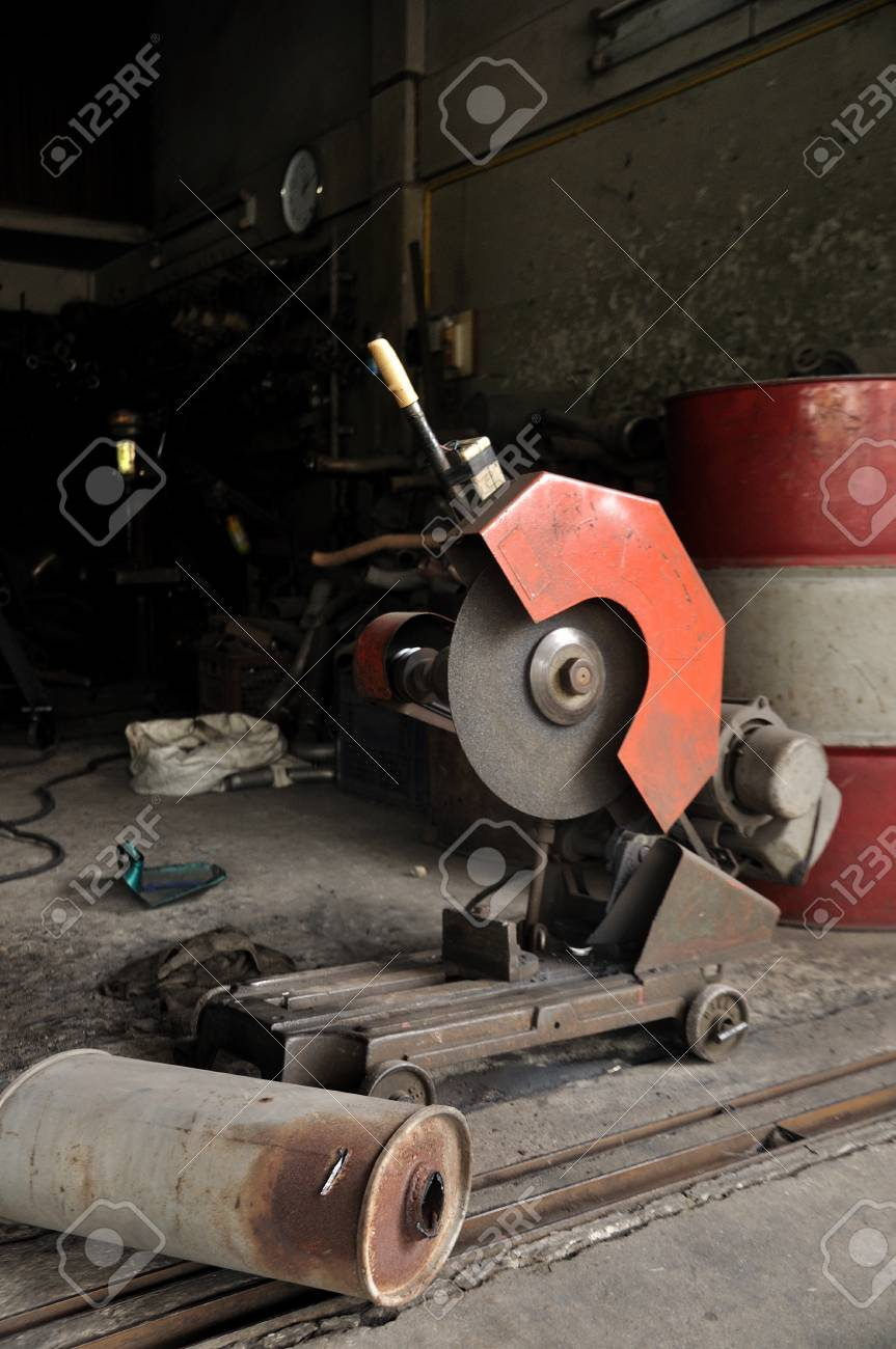 cutting grinder and old exhaust pipe