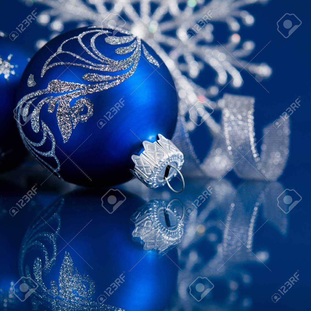 Blue And Silver Christmas Ornaments On Dark Blue Xmas Background Stock Photo Picture And Royalty Free Image Image 32790782