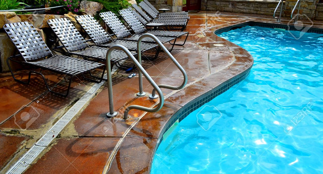 Chairs For Pool Deck Chairs Next To Swimming Pool With Blue Water