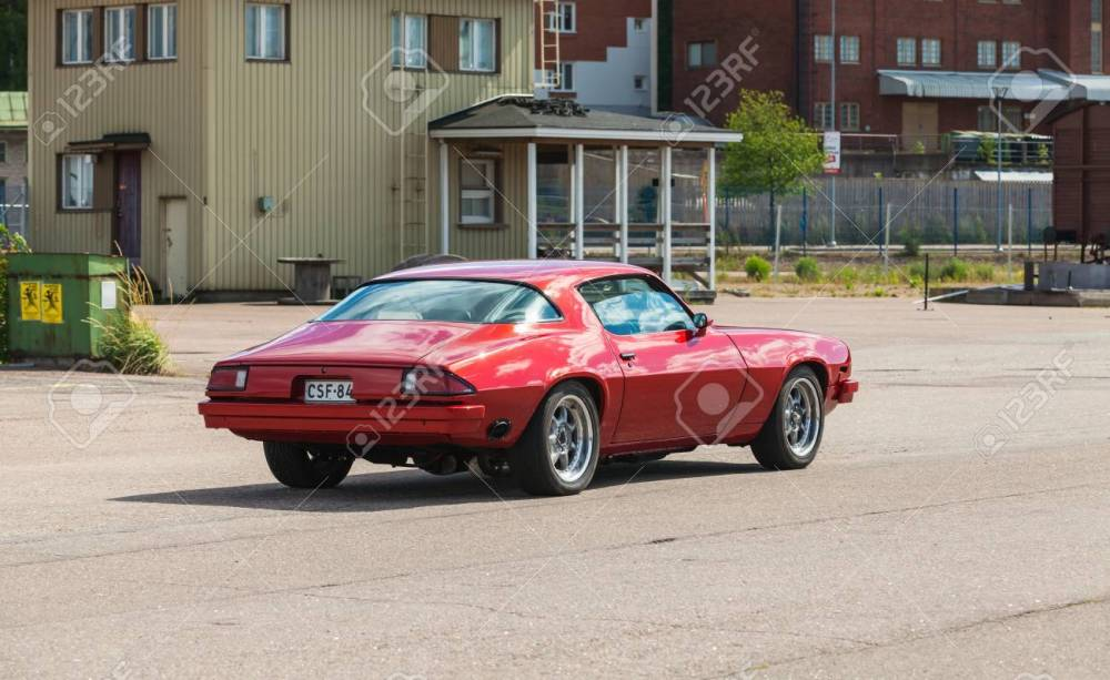 medium resolution of kotka finland july 16 2016 red 1976 chevrolet camaro sport goes down