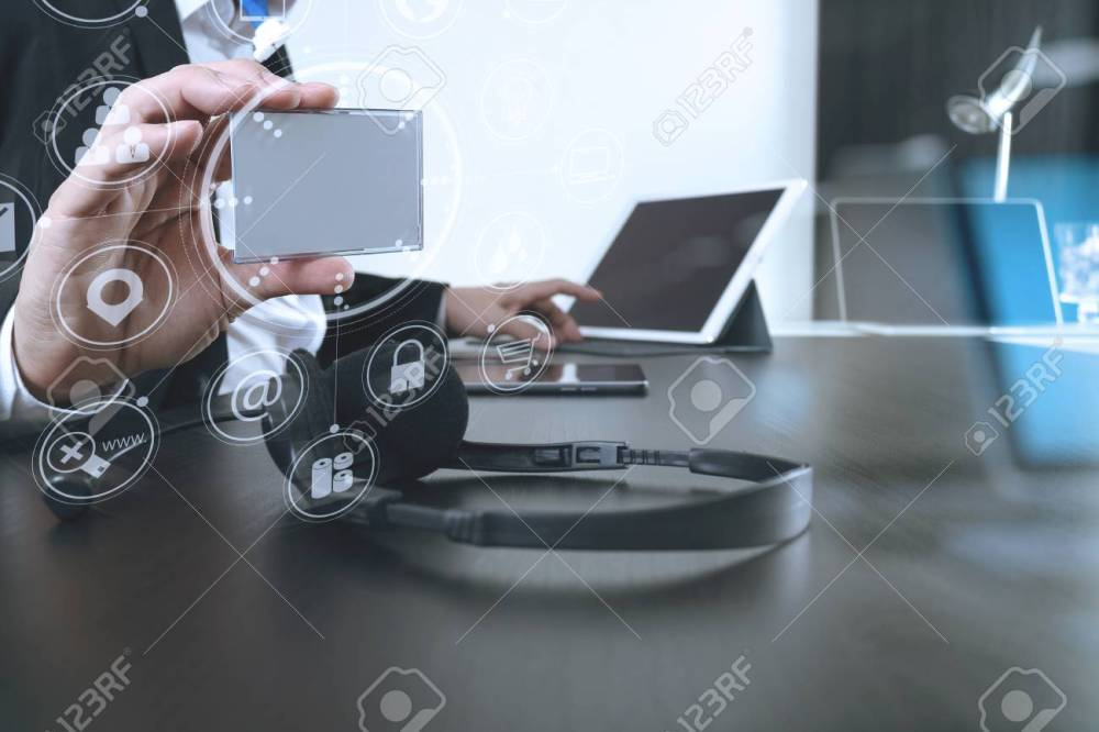 medium resolution of man using voip headset and show id tag with digital tablet and laptop computer as concept