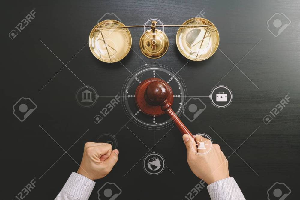 medium resolution of top view of male judge hand in a courtroom with the