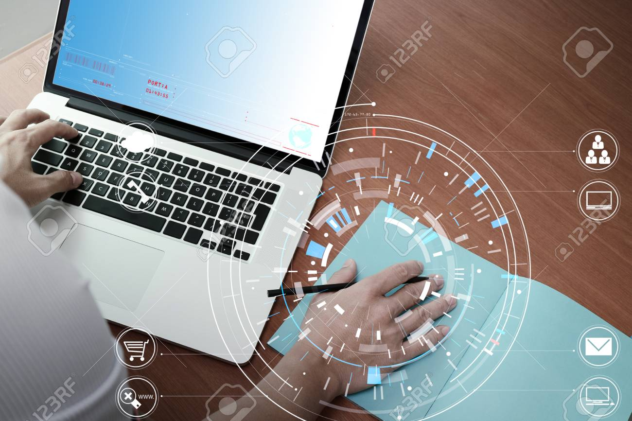 hight resolution of businessman hand working with modern laptop computer in modern office with virtual icon diagram stock photo