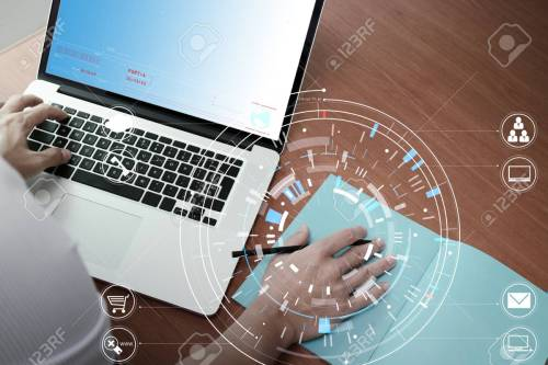 small resolution of businessman hand working with modern laptop computer in modern office with virtual icon diagram stock photo