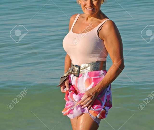 Attractive Mature Woman Wading In The Ocean Stock Photo 8067407