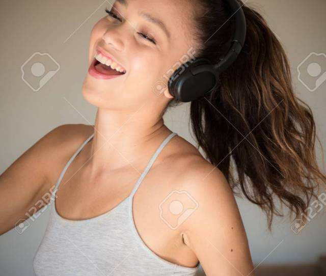 Stock Photo Young Asian Teen Woman Portrait Closed Eyes Smiling And Dancing With Headphones Female Lifestyle