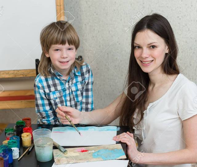 Stock Photo Young Beautiful Mother With Boys Son Paint Colors At Home Mom Teaches Son To Paint Colors