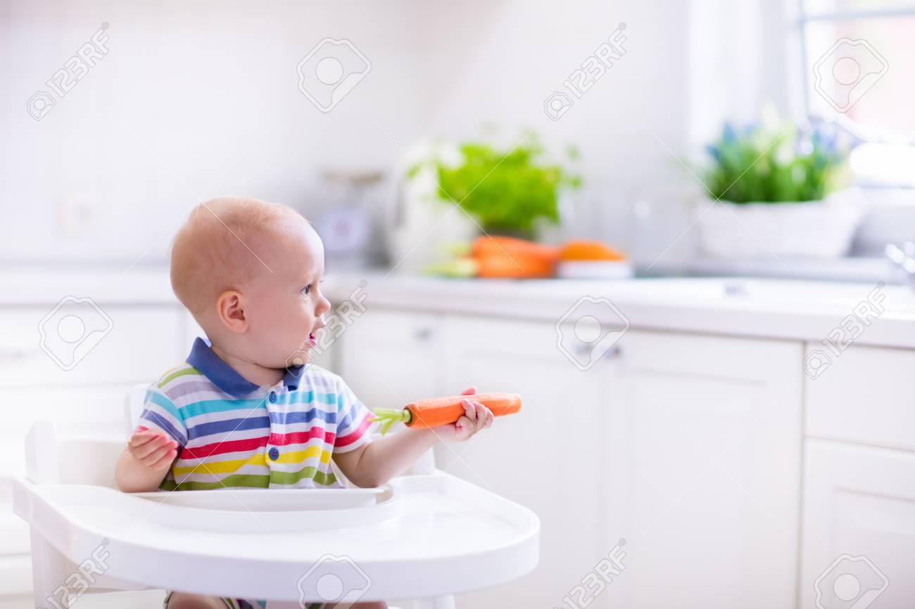 baby chairs for eating carl and ellie happy sitting in high chair carrot a white kitchen healthy nutrition