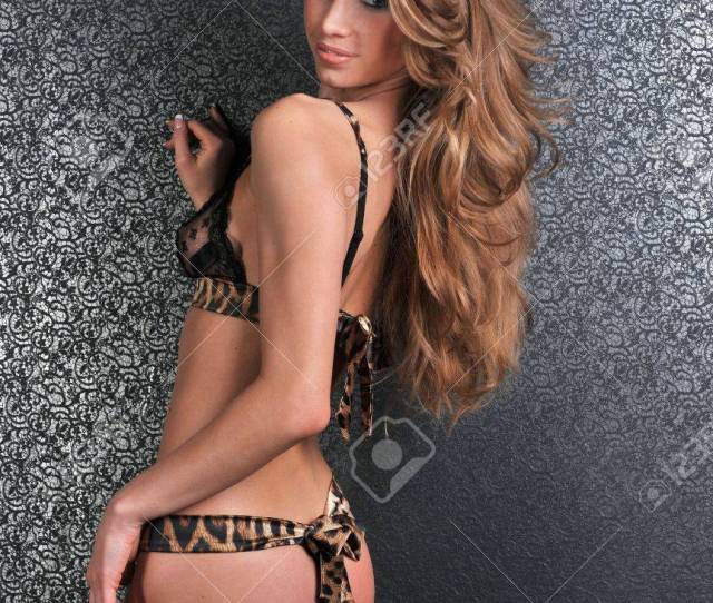 Sexy Lingerie Model Posing Pretty At Studio Vintage Background Set Wearing Black Corset Bra