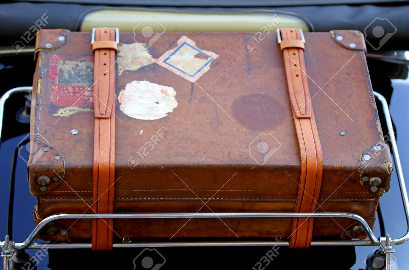 old suitcase in the luggage rack of vintage car before a trip stock photo picture and royalty free image image 29170698