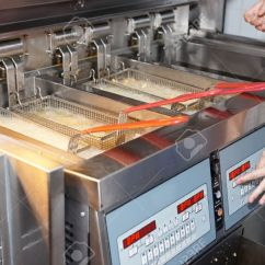 Kitchen Fryer Plaques Deep With Boiling Oil On Restaurant Stock Photo 12861232