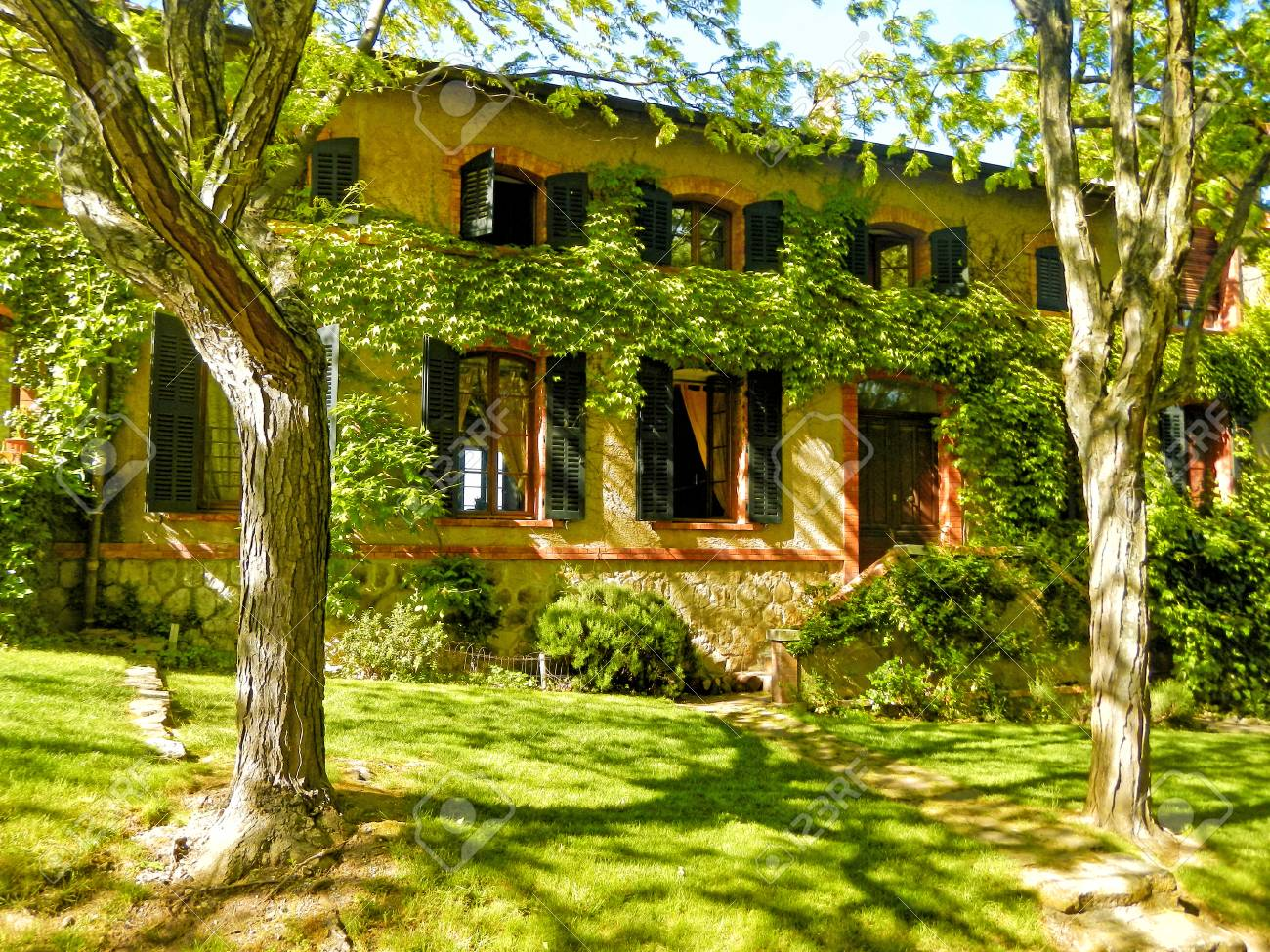 Old French Farmhouse With Shutters Windows In The Garden Provence
