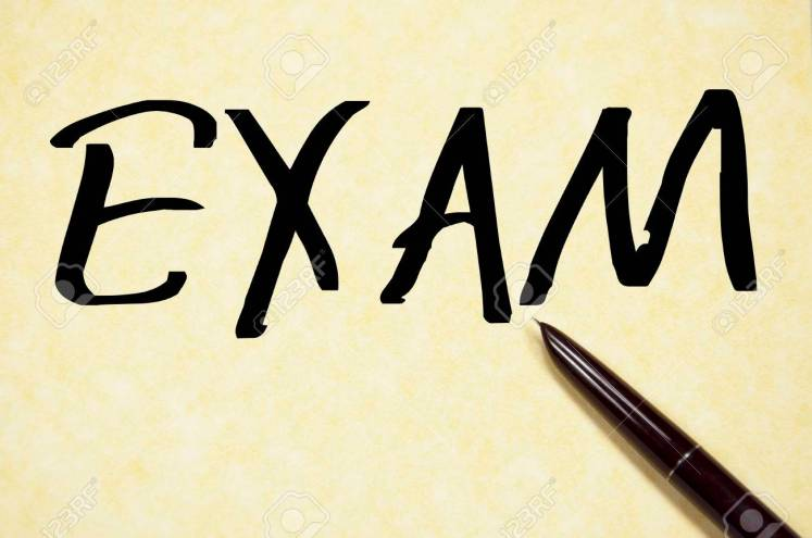 Exam Word Write On Paper Stock Photo, Picture And Royalty Free ...