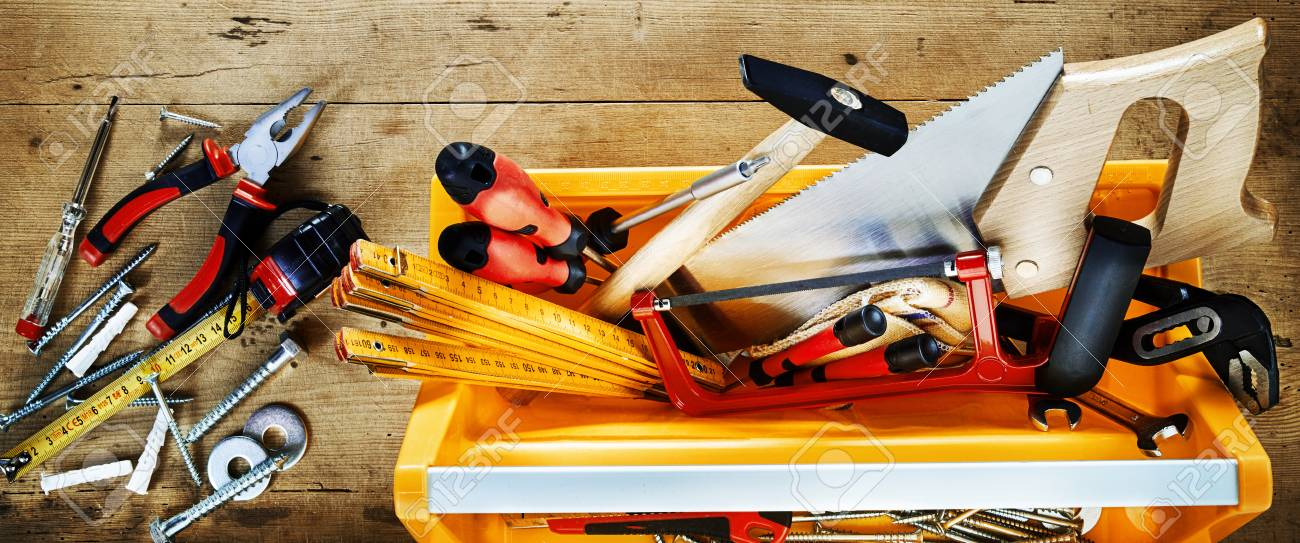 https www 123rf com photo 107768305 colorful yellow tool box with assorted diy hand tools for renovation woodworking or construction on html