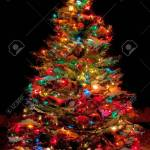 Snow Covered Christmas Tree With Multi Colored Lights At Night Stock Photo Picture And Royalty Free Image Image 33176825