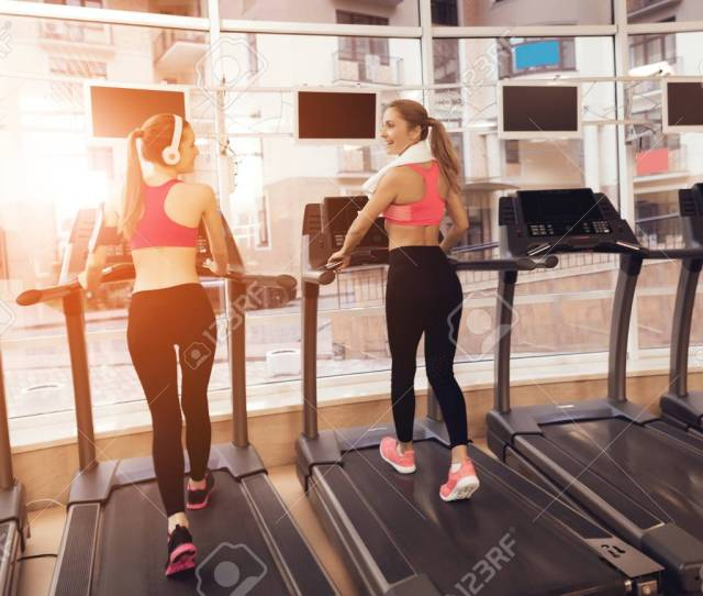 Stock Photo Two Women In Sportswear Running On Treadmill At The Gym They Look Happy Fashionable And Fit
