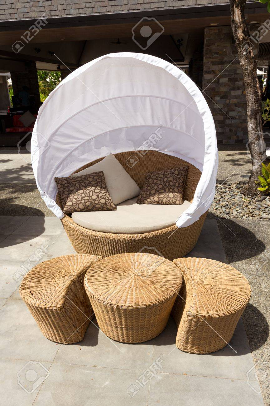round sofa chair made from bamboo with white tent cover on outdoor