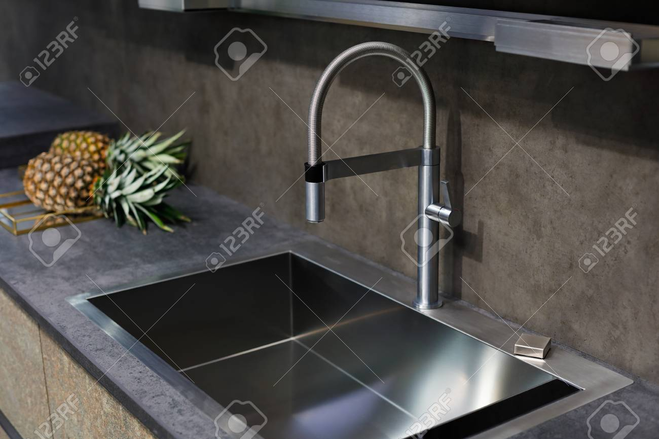 https www 123rf com photo 97548316 stainless steel sink with a tap on a kitchen counter html