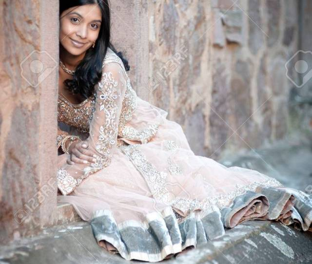 Stock Photo Young Beautiful Indian Woman With Single White Rose Against Brick Building