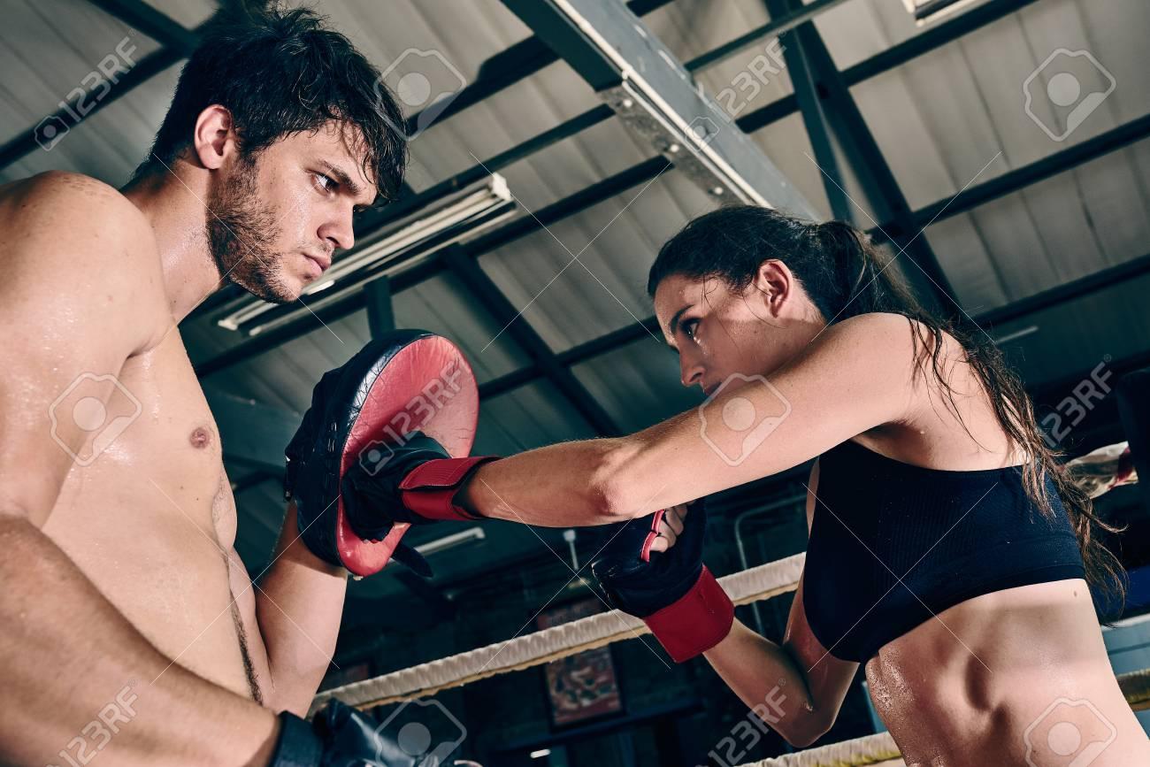 man woman training gym