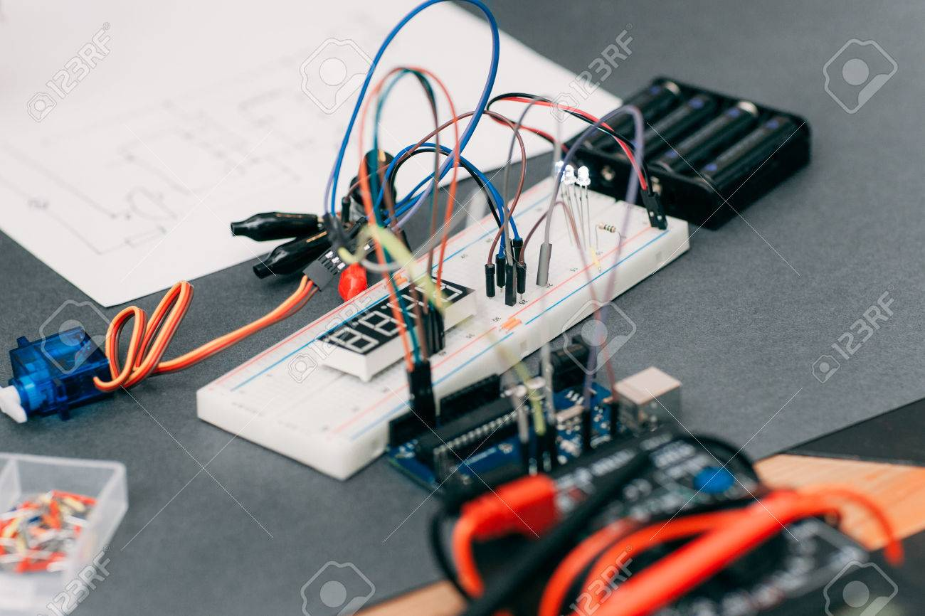 hight resolution of electronic construction with wiring diagram modern engineering creation on gray table breadboard with colorful