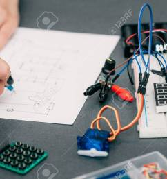 stock photo wiring diagram drawing with breadboard electronic construction developing female engineer in [ 1300 x 866 Pixel ]